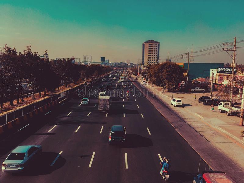 Cars in Black Concrete Road in Landscape Photography royalty free stock photos