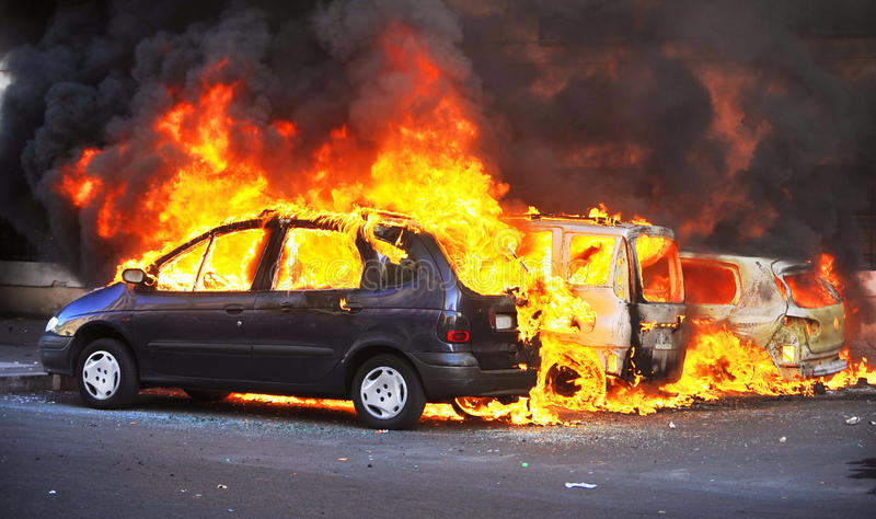Cars Burning. Riots - Cars Burning in the street royalty free stock photo