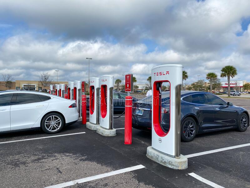 Cars Charging At A Tesla Supercharger Station In Florida ...