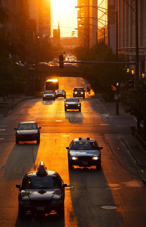 Cars in city. Cars traffic in a city at sunset royalty free stock photography