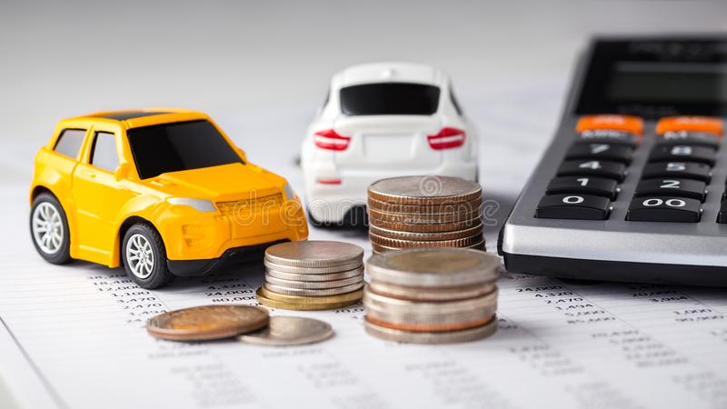 Cars, coins and calculator, car trading. Cars and coins with calculator on financial statement stock image