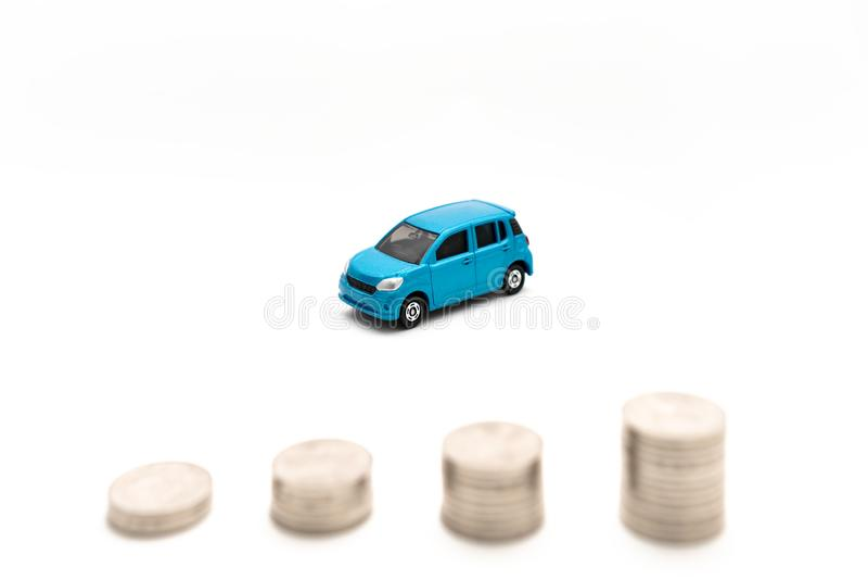 Cars and coins in white background royalty free stock photography