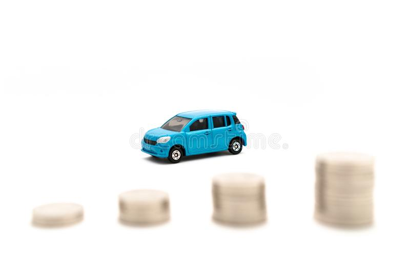 Cars and coins in white background royalty free stock photos