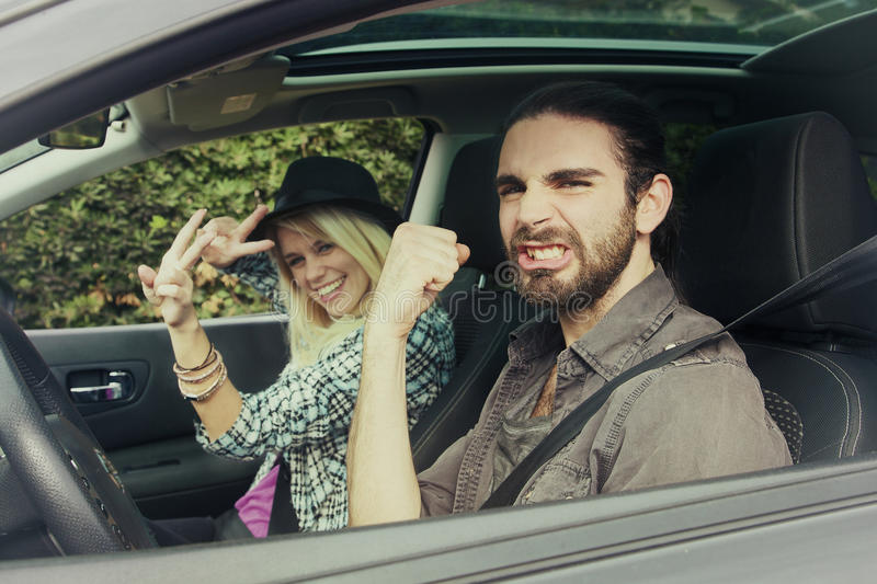 Cars - couple driving in new car smiling happy, looking at camera stock images