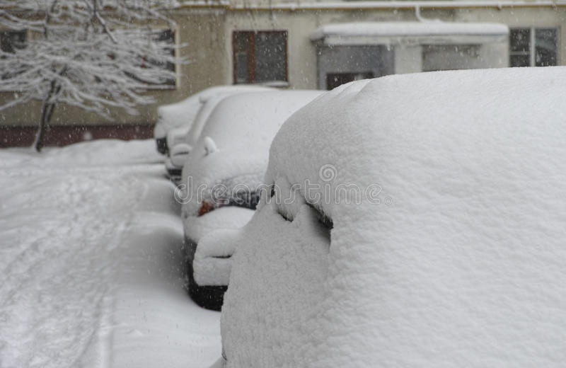 Cars covered in snow stock images