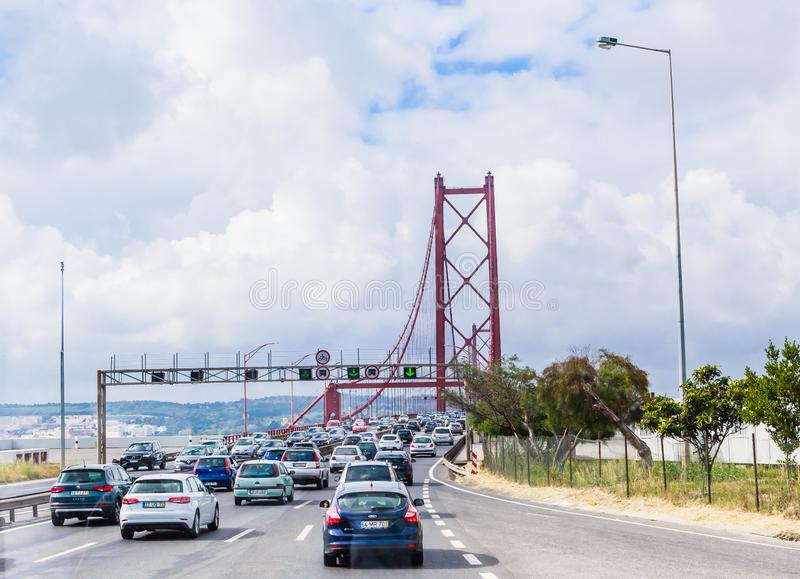 View of Cars crossing the Ponte 25 de Abril bridge over the Tejo river in Lisbon, Portugal, Europe royalty free stock images