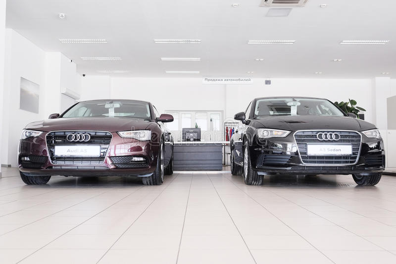 Cars in a dealer's showroom in Moscow, Russia. Moscow, Russia, May, 8, 2015: image of a Cars in a dealer's showroom in Moscow, Russia stock images