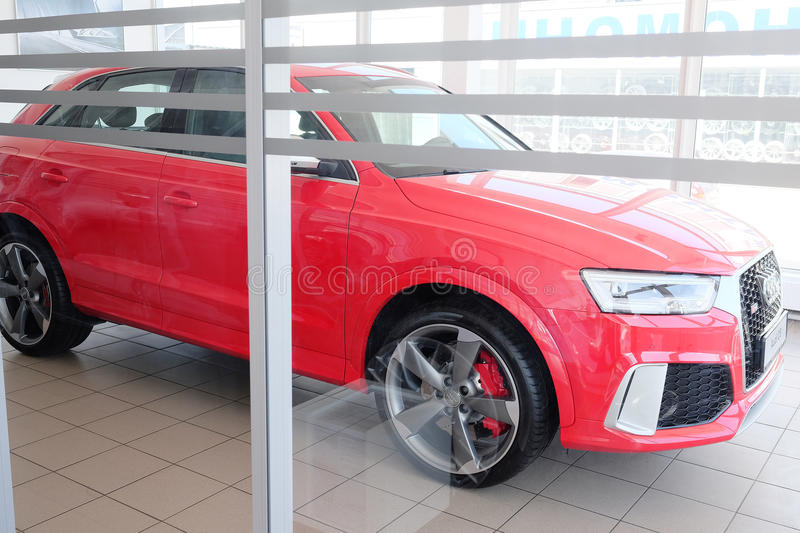 Cars in a dealer's showroom. Tula, Russia, May, 8, 2015: Cars in a dealer's showroom in Tula, Russia. Today business on car sale has not the best times royalty free stock image