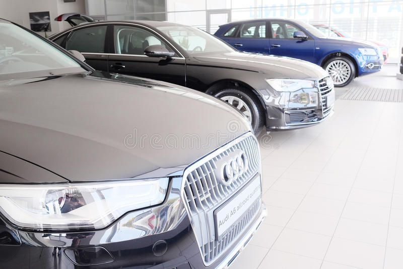 Cars in a dealer's showroom. Tula, Russia, May, 8, 2015: Cars in a dealer's showroom in Tula, Russia. Today business of car sale has not the best times royalty free stock photos