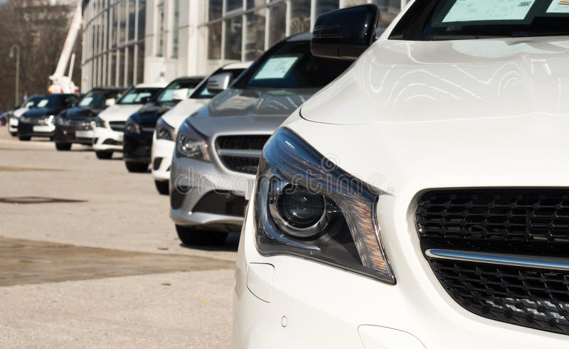 Cars in a diagonal row. Cars for sale in a diagonal row royalty free stock photos