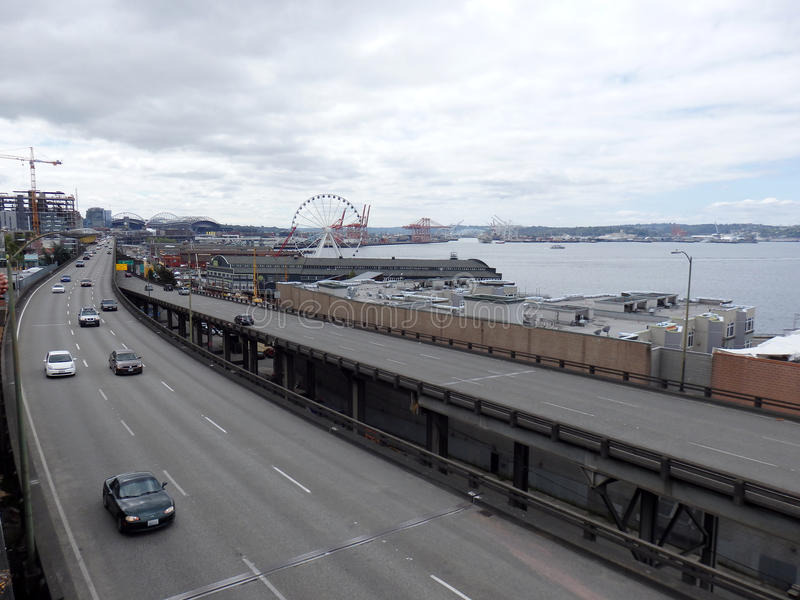Cars drive along State Route 99 runs along the Seattle seaboard royalty free stock photo
