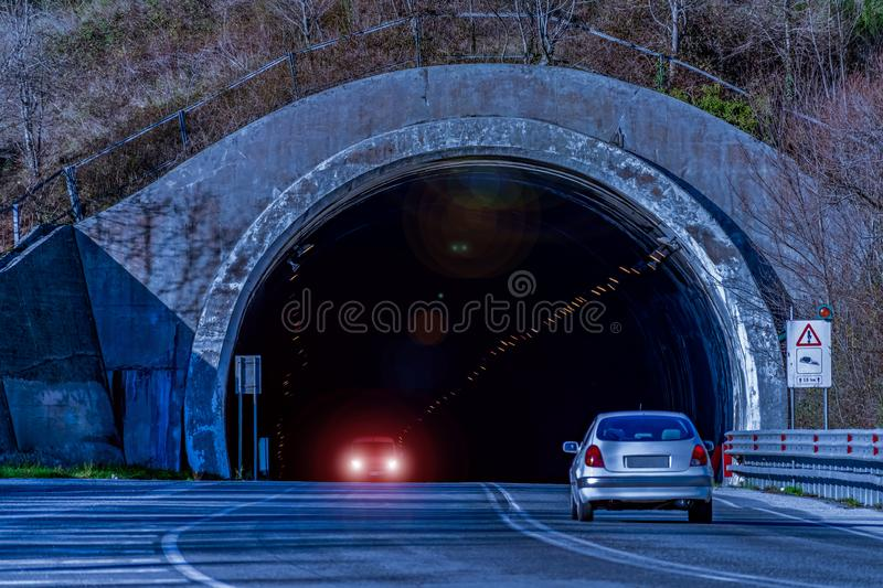 Cars drive through a road tunnel royalty free stock image