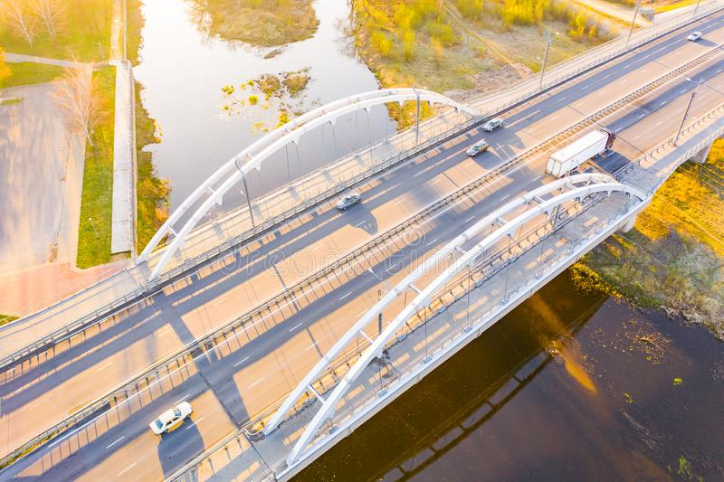 Cars driving across bridge in city area stock photography