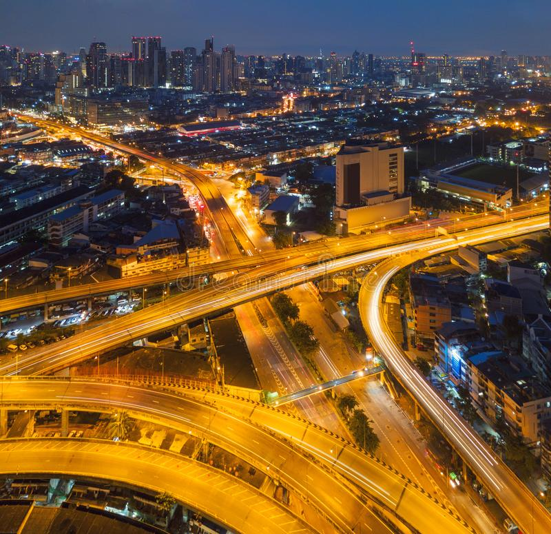 Cars driving on bridge roads shaped curve highways with skyscraper buildings. Aerial view of Expressway Bangna, Klong Toey in. Structure of architecture concept royalty free stock photo