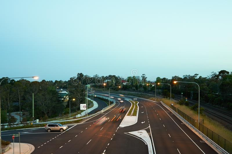 Cars driving at dusk. On the newly updated Great Western Highway at Hazelbrook in the Blue Mountains, Australia royalty free stock images