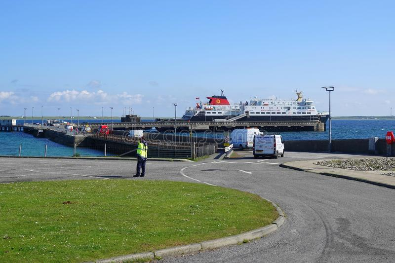 Cars driving to car ferry. Vehicles approaching the Caledonian Macbrayne car ferry `Clansman` at the ferry terminal on the island of Tiree in Scotland stock photos