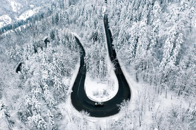 Cars driving trough severe snowfall weather highway in the mountains royalty free stock photo