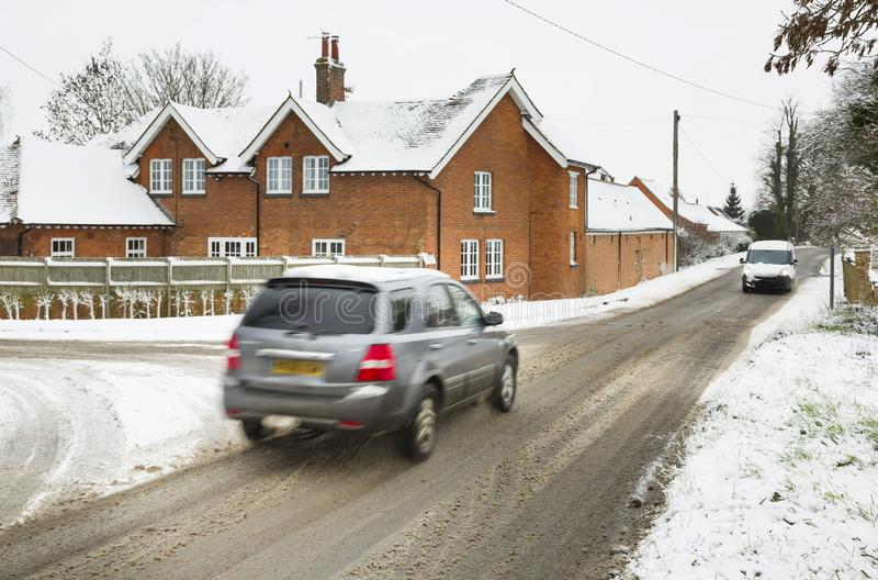 Cars driving in winter snow UK stock images