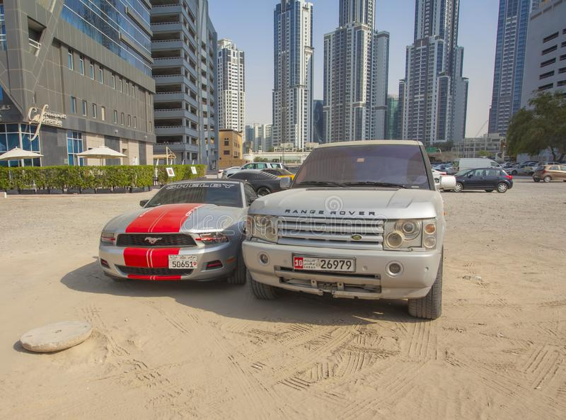 Cars in dust parking place, Dubai city view royalty free stock image