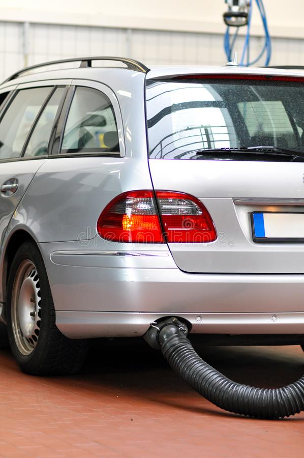 Cars for emission test in a garage. Closeup photo stock photography