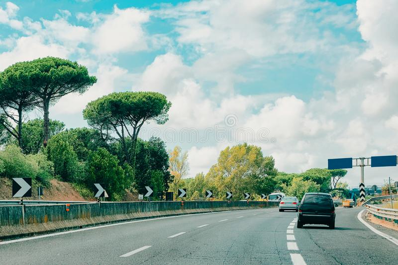 Cars and empty blue traffic signs in road in Italy. Cars and empty blue traffic signs in the road in Italy stock image