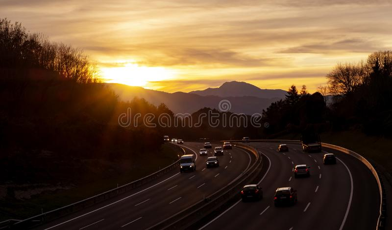 Cars on highway road on sunset royalty free stock photography