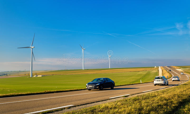Cars on a highway and wind turbines in the background - France. Marne Department royalty free stock images