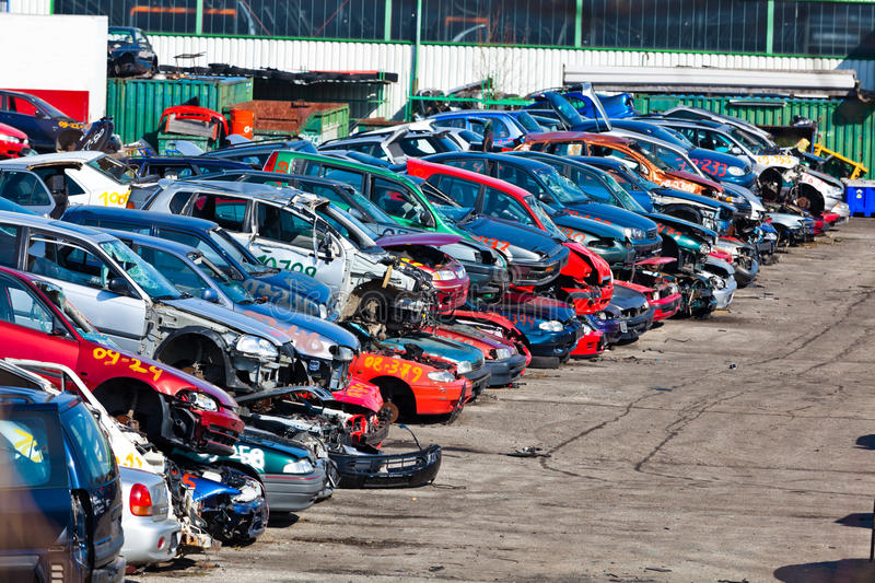 Cars in a junkyard. Old cars are appelt confess to a scrap yard. Scrap cars in a junkyard royalty free stock photo