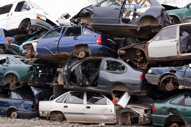 Cars in junkyard. Piled up destroyed cars in the junkyard royalty free stock photography