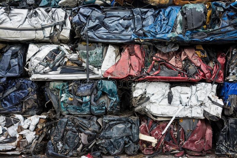 Cars in junkyard,  pressed and packed for. Recycling stock photography