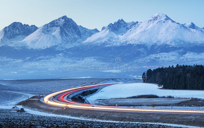 Cars lights on the highway in morning time. In Slovakia stock photography