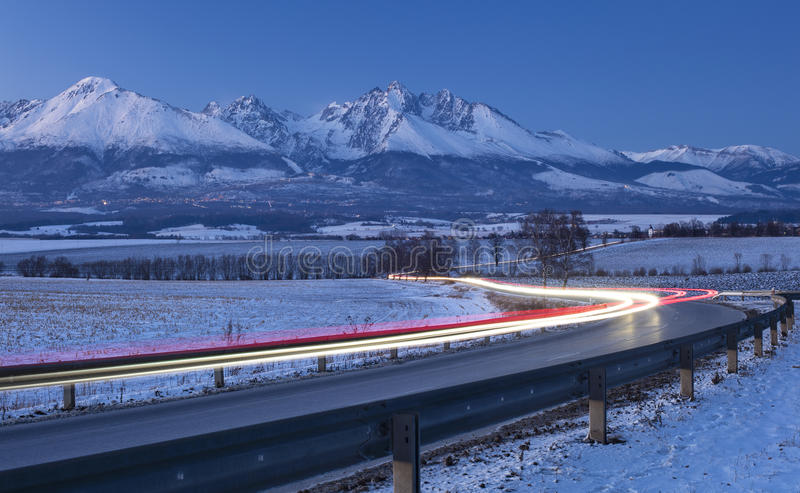 Cars lights on the road in winter morning. Night cars lights on the road in winter morning in Slovakia stock photography