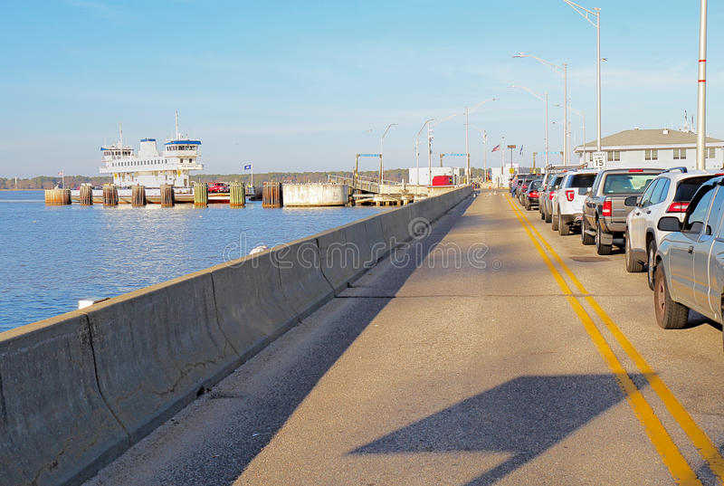 Cars in line for the Jamestown Ferry from Surrey, Virginia stock image