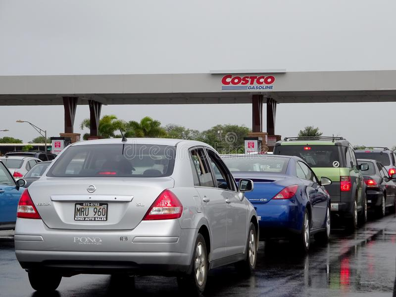Cars line up for Costco Gasoline. Maui - January 25, 2015: Cars line up for Costco Gasoline. Costco Gasoline Significantly reduces harmful pre-existing deposit royalty free stock images