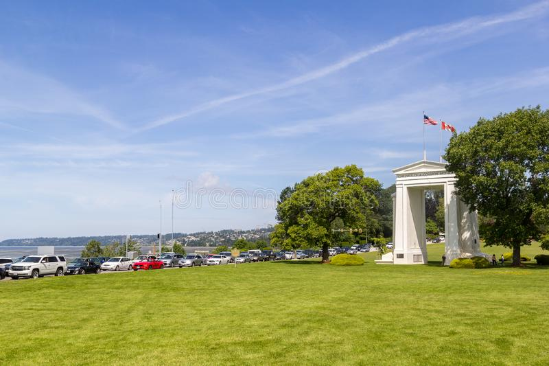Cars lining up at the Canada - US Peace Arch border royalty free stock image