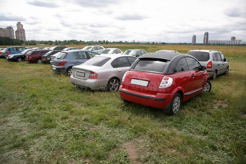 Cars on the meadow stock photography