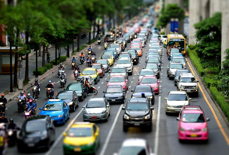 Cars and motorcycles in busy road with tilt shift effect royalty free stock images