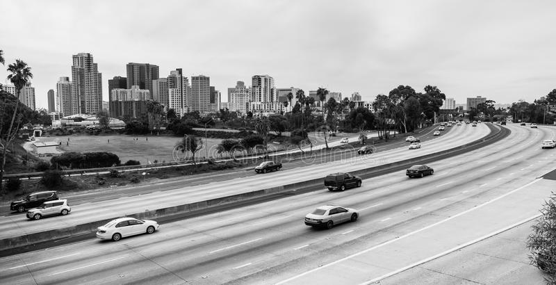 Cars Move I-5 Downtown San Diego California Skyline Transportati. Black and white rendering of San Diego and autos moving on the highway stock images