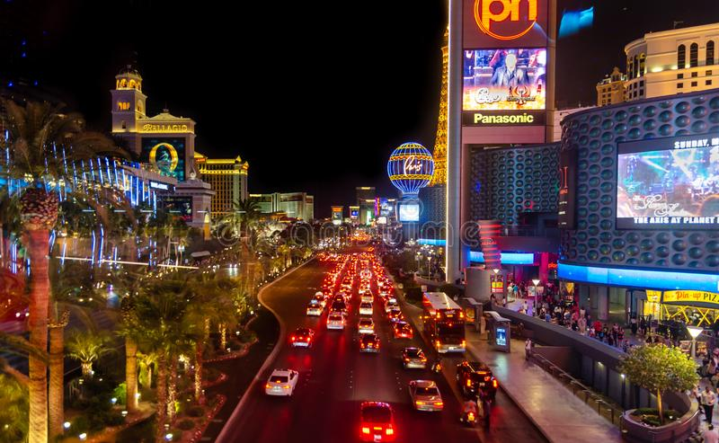 Cars at one of central streets of Las Vegas. Night time. LAS VEGAS, USA - MAY 23, 2015: Cars at one of central streets of Las Vegas. Night time stock images