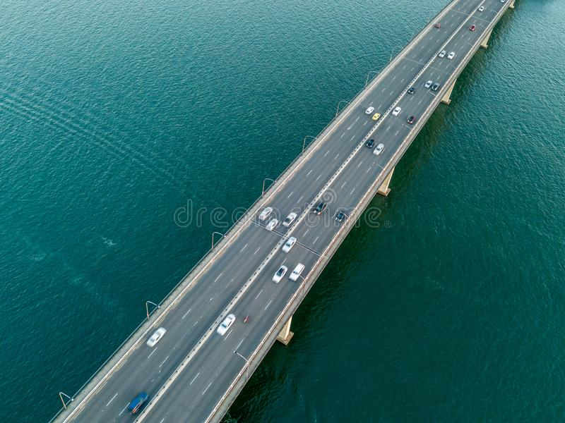Vehicles on bridge over water stock photo