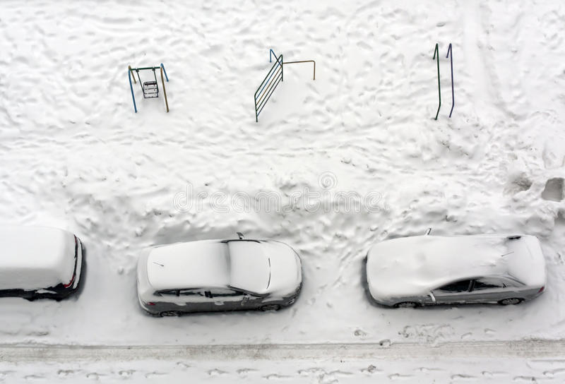 Cars parked in snow. royalty free stock photos