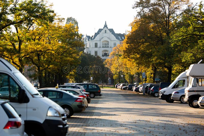 Cars parked on the street. Autumn in the city royalty free stock photo