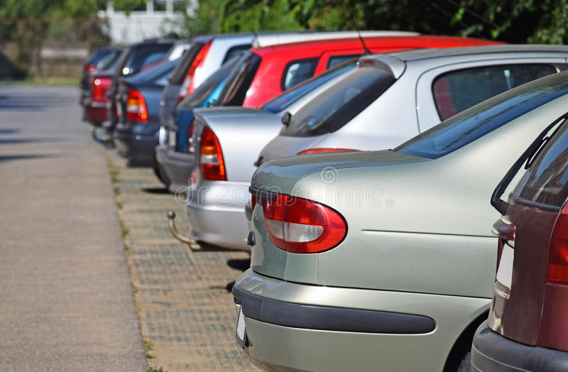Cars in the parking lot royalty free stock photos