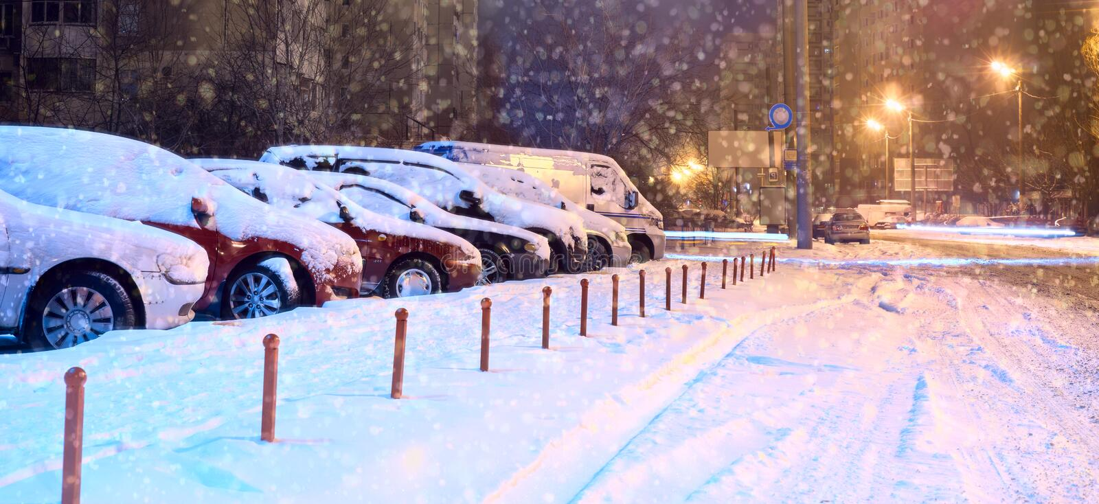 Cars in the parking lot in the winter.  stock photo