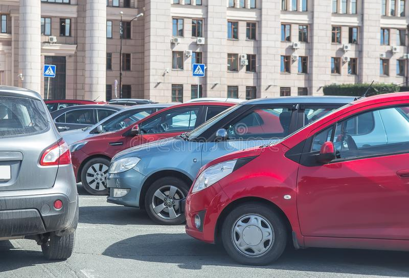 Cars in parking place near classic style building. stock photography