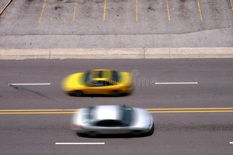 Cars Pass In Motion royalty free stock photos
