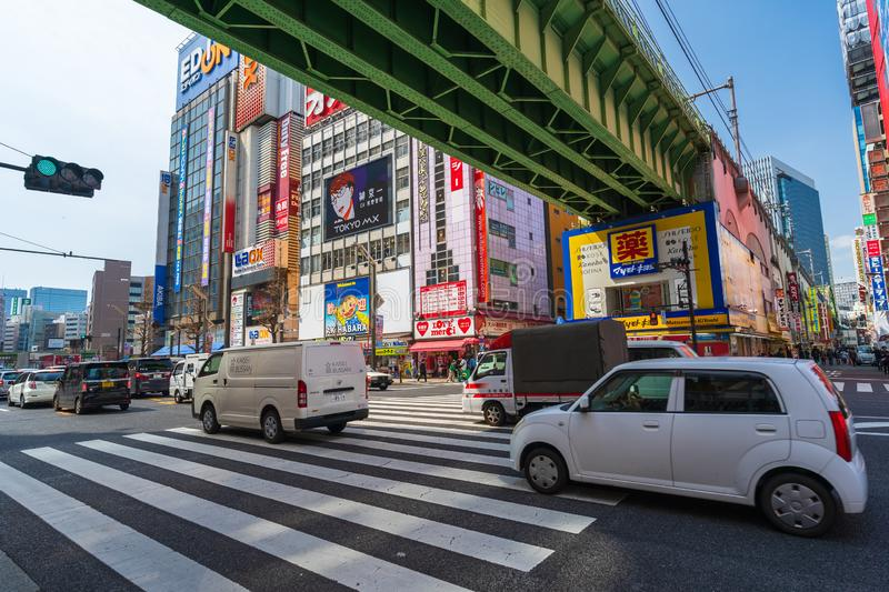 Cars pass through street in Akihabara at Tokyo, Japan. Akihabara, JAPAN - March 25, 2019: Cars pass through street in Akihabara at Tokyo, Japan royalty free stock image
