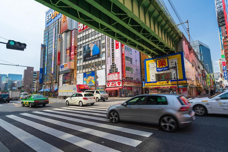 Cars pass through street in Akihabara at Tokyo, Japan. Akihabara, JAPAN - March 25, 2019: Cars pass through street in Akihabara at Tokyo, Japan stock image
