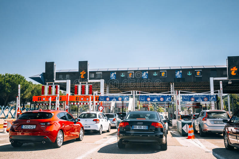 Cars passing through the point of toll highway, toll station. royalty free stock photos