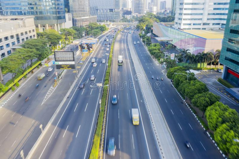 Cars passing through road with fast motion stock photography